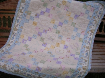 Embrodered Baby Love Quilt image